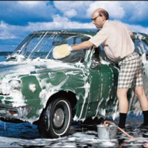 Photo of Man washing a green car
